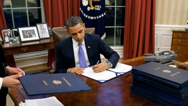 president obama signs government spending bill