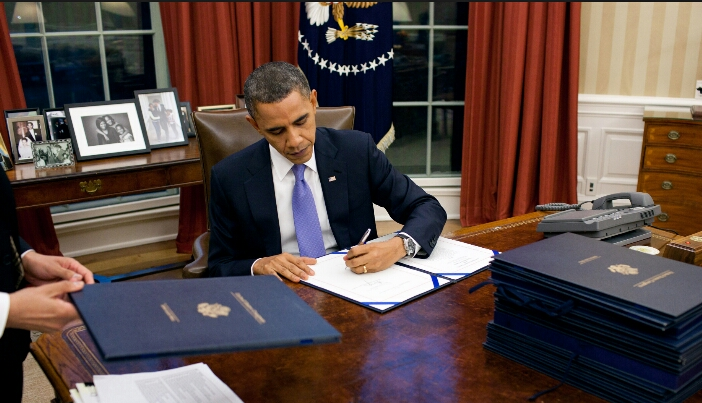 President Obama signing 2015 spending bill